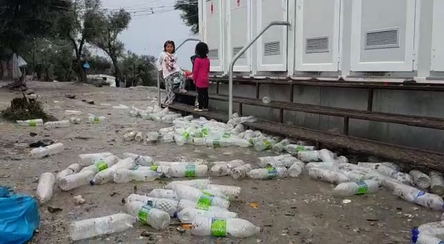 Bottles, trash and mud in camp moria.