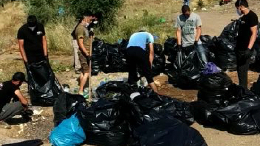 A team of refugees is collecting all the trash to keep camp moria as clean as possible